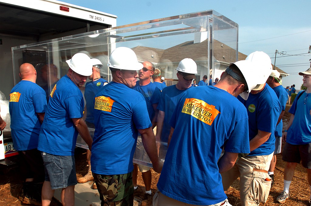 Extreme Makeover: Home Edition workers move a custom 600-gallon aquarium by Indoor Oceans into the home they are working on in Clarksville, TN.